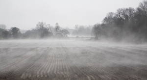 Morning fog rising from wet fields, Alderton, Suffolk, England