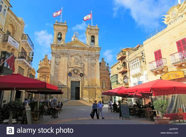 Basilica church and cafes in Saint George's square, Plaza San Gorg,  Victoria Rabat, island of Gozo, Malta