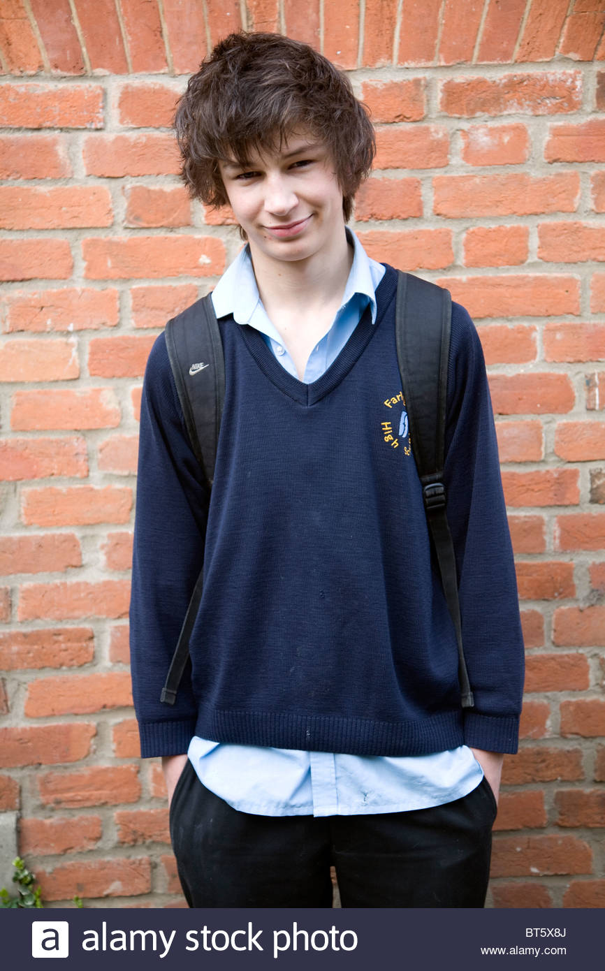 Teenage boy wearing navy blue school uniform